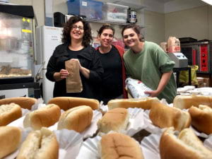 group of faculty staff with bread in front