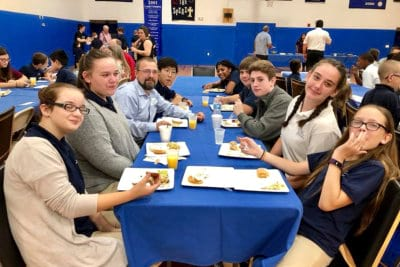 students eating at the table