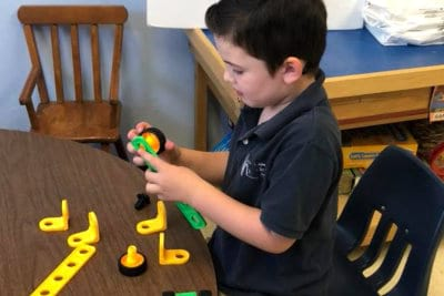 student playing toys