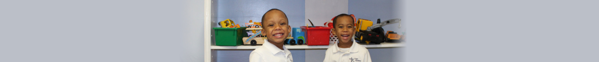 Two young boys smiling